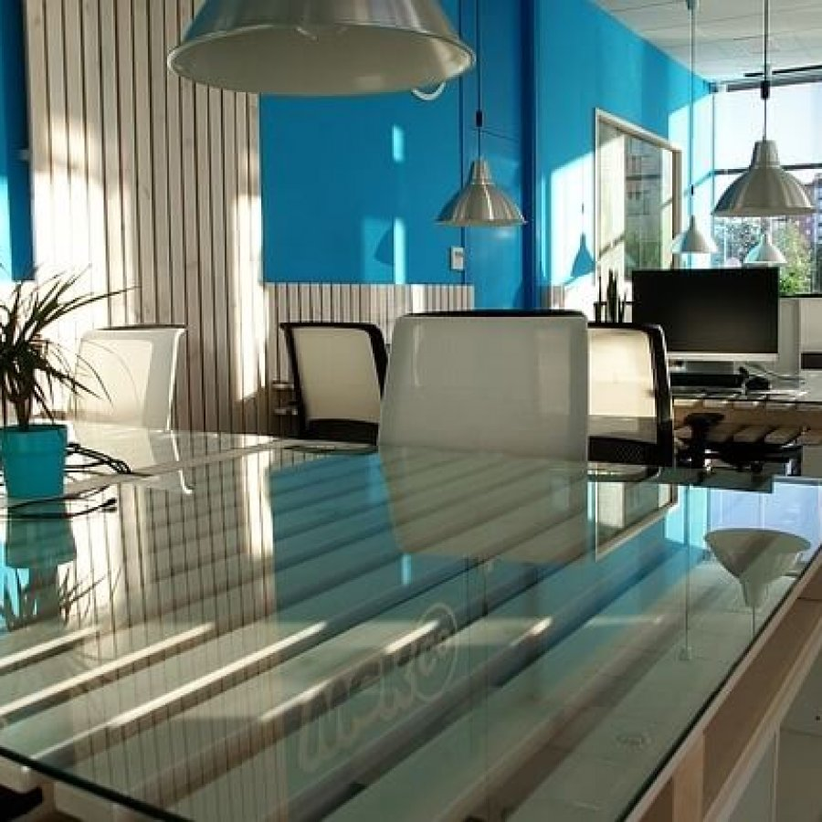 office with glass tables and blue walls