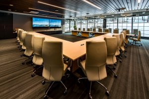 Mimecast's large conference room with square conference table with open middle